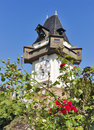 Rose garden and clock tower Uhrturm in Graz, Austria Royalty Free Stock Photo