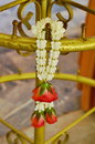 Rose garland wreathe on brass pole the Stock Photography