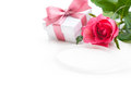 Rose and gift box over white background Stock Photo