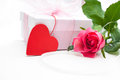 Rose and gift box over white background Stock Images