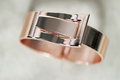 Rose gold bangle fashion hinged bracelet macro Royalty Free Stock Photos