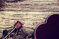 Rose and Heart Shaped Box on Rustic Wood Royalty Free Stock Photo