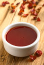Rose hip jam homemade in bowl with dried rosehip on the side photographed on wood with natural light selective focus focus in the Stock Photography