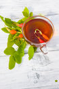 Rose hip tea on wooden background Royalty Free Stock Image