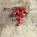 Rose hips on a wooden table close up photo Stock Photography