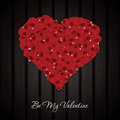 Rose petals beautiful heart made from on wooden texture vector background Stock Photos