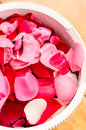 Rose petals different colors in a bowl Royalty Free Stock Images