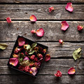 Rose petals inside open gift box Royalty Free Stock Photo