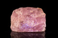 Rose quartz in front of black Royalty Free Stock Photo