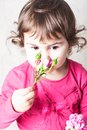 Rose smell little girl is smelling the roses close up face Royalty Free Stock Photo