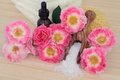 Rose spa bodycare flower arrangement with aromatherapy essential oil bottle sea salt sponge and towel stack carefree days variety Royalty Free Stock Photos