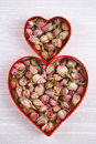 Rose tea buds in heart shape cutters Stock Photos