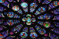 Rose window notre dame paris holy figures lit stories many colors Stock Photos