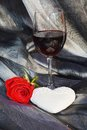 Rose, wine and heart on silvered background Royalty Free Stock Photo