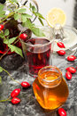 Rosehip tea with honey and lemon in glass Stock Photos