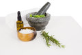 Rosemary and mortar and pestle with aromatherapy oil Royalty Free Stock Photo