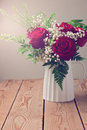 Roses bouquet close up on wooden table Royalty Free Stock Photo