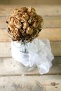 Roses bouquet in a glass jar decoration on wooden pallet table Royalty Free Stock Photos