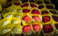 Roses bouquets of colorful in yellow tissue paper on flower market Stock Photo