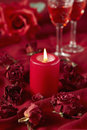 Roses and burning candle Stock Image