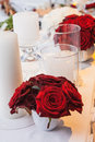 The roses and candles on celebratory table red Royalty Free Stock Images