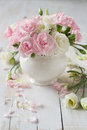 Roses and carnation in vase Royalty Free Stock Photo