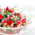 Roses fake  flower bouquet in white basket Royalty Free Stock Photo