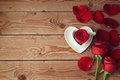 Roses and flower petals on wooden background with copy space. Valentine's day concept