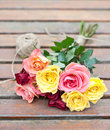 Roses from the garden a bunch of on a table tight with a string Royalty Free Stock Images