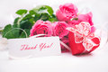 Roses and gift box with a card Royalty Free Stock Images