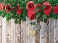 Roses and a hearts on wooden board, Valentines Day holiday background Royalty Free Stock Photo