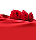 Roses on red silk Royalty Free Stock Photo