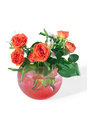 Roses and tiger lilies in a vase of red hydrogel balls super absorbent polymers Royalty Free Stock Image