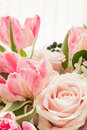 Roses and tulips pink delicate in a bouquet Stock Photo