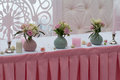 Roses in a vase and candles on the table Royalty Free Stock Photo