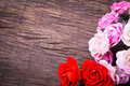 Roses on wooden table bouquet top Royalty Free Stock Images