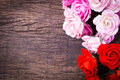 Roses on wooden table bouquet top Royalty Free Stock Photos