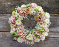 Roses wreath on wooden background Royalty Free Stock Photo