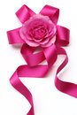 Rosette composed of pink ribbon and pink rose Royalty Free Stock Photography