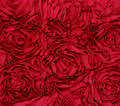 Rosette red fabric background rose Stock Photography