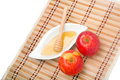 Rosh ha shana snack apples and honey a jewish new year celebration on a straw mat Royalty Free Stock Photos