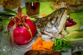 Rosh Hashanah, dish with the fish head, fruits and vegetables Royalty Free Stock Photo