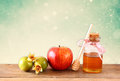 Rosh hashanah jewesh holiday concept honey apple and pomegranate over wooden table traditional holiday symbols Stock Image