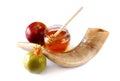 Rosh hashanah jewesh holiday concept shofar horn honey apple and pomegranate isolated on white traditional holiday symbol symbols Royalty Free Stock Images