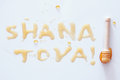Rosh hashanah jewish New Year holiday concept. SHANA TOVA Text in hebrew that mean HAPPY NEW YEAR. Royalty Free Stock Photo