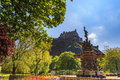 Ross fountain landmark in Pincess Street Gardens and Edinburgh Castle Royalty Free Stock Photo