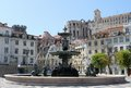 Rossio square lisbon portugal fountain with ruins and buildings in the background Royalty Free Stock Photography