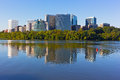 Rosslyn skyscrapers in the early morning with reflections in Potomac River. Royalty Free Stock Photo