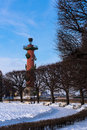 Rostral column behind trees Stock Image
