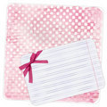 Rosy background with note paper and bow Royalty Free Stock Photography